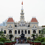 Ho Chi Minh City Hall during the day. It was built in the early 20th Century by the French colonial government as Saigon's city hall. It's also known as Ho Chi Minh City People's Committee Head office, in French as Hôtel de Ville de Saigon, and in Vietnamese as Tr? s? ?y ban Nhân dân Thành ph? H? Chí Minh.
