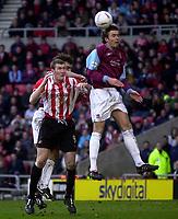 Photo. Glyn Thomas.<br /> Sunderland v West Ham United.<br /> Nationwide Division 1.<br /> Stadium of Light, Sunderland. 13/03/2004.<br /> West Ham's Christian Dailly (R) rises above Sunderland's Kevin Kyle, who scored his side's first goal.