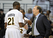 Feb 19, 2011; Long Beach, CA, USA; Long Beach State 49ers coach Dan Monson (right) talks with guards Larry Anderson (21) and Casper Ware (22) during the game against the Montana Grizzlies at the Walter Pyramid. Long Beach State defeated Montana 74-56.