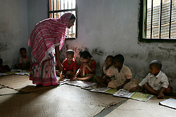 BANGLADESH CHITTAGONG 9MAR05 - Shishu (baby) class with Shohima Aktar, a teacher who has worked at St. Athony's Free School for children from poor backgrounds in Motighorna, Pahartuli, Chittagong, Bangladesh for six years. The school was set up as a charity five years ago and provides free basic education for children from the ages of 4 to 7 years. Subjects taught include Bangla, Maths and English. ..jre/Photo by Jiri Rezac..© Jiri Rezac 2005..Contact: +44 (0) 7050 110 417.Mobile:  +44 (0) 7801 337 683.Office:  +44 (0) 20 8968 9635..Email:   jiri@jirirezac.com.Web:    www.jirirezac.com..© All images Jiri Rezac 2005 - All rights reserved.