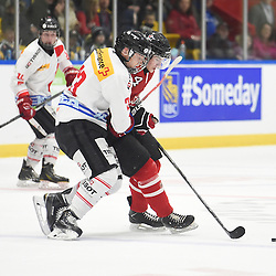 WHITBY, - Dec 13, 2015 -  WJAC Game 2- Team Switzerland vs Team Canada East at the 2015 World Junior A Challenge at the Iroquois Park Recreation Complex, ON. Philipp Kurashev #23 of Team Switzerland battles for control with Ben Sokay #24 of Team Canada East during the second period.<br /> (Photo: Andy Corneau / OJHL Images)