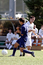 01 October 2006: Crusader Mitch Boersma takes the ball from the Titans. The game remained scoreless until the 2nd overtime in which University of Dallas Crusaders Adam Lunger scored the Golden Goal to beat the Illinois Wesleyan Titans.  This game was played at Neis Field on the campus of Illinois Wesleyan University in Bloomington Illinois.