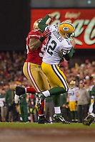 12 January 2013: Quarterback (12) Aaron Rogers of the Green Bay Packers is rushed by (55) Ahmad Brooks of the San Francisco 49ers during the first half of the 49ers 45-31 victory over the Packers in an NFL Divisional Playoff Game at Candlestick Park in San Francisco, CA.