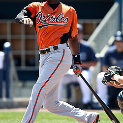 March 20, 2011; Port Charlotte, FL, USA; Baltimore Orioles center fielder Adam Jones (10) during a spring training exhibition game against the Tampa Bay Rays at Charlotte Sports Park.   Mandatory Credit: Derick E. Hingle