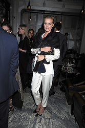 EVA HERZIGOVA at a party for Yves Saint Laurent's Creative Director Stefano Pilati given by Colin McDowell held at The Connaught Bar, The Connaught, Mount Street, London on 29th October 2008.