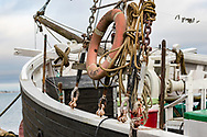 Detail from the front of a House Boat, with ropes, lifesaver and boxes to keep nessecary things in.