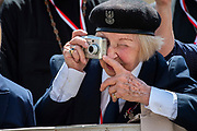 A Woman taking pictures during Pope Francis General Audience at St. Peter's square in the Vatican