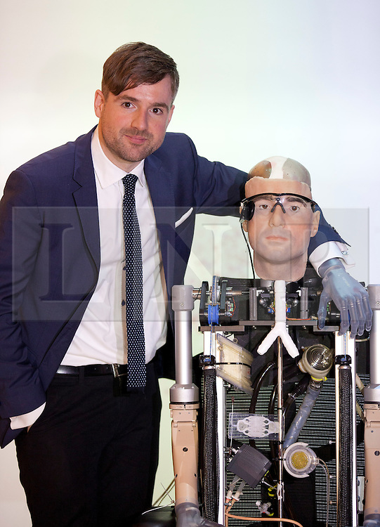 © Licensed to London News Pictures. 05/02/2013. London, UK. Television presenter and prosthetic user Bertolt Meyer stands next to a bionic man made completely from replacement body parts, including a face modelled on Meyer's, at the Science Museum in London today (05/02/13). The artificial man, made up of different costing around US$1,000,000, stands at . Photo credit: Matt Cetti-Roberts/LNP