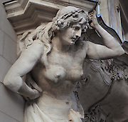 Detail of a sculpted female caryatid figure supporting a window ledge on the Splendid Hotel building, erected 1904 in Neo-Baroque style with art nouveau elements, on Dorotheenstrasse, Mitte, Berlin, Germany. The building is now a delicatessen and travel agent. Picture by Manuel Cohen