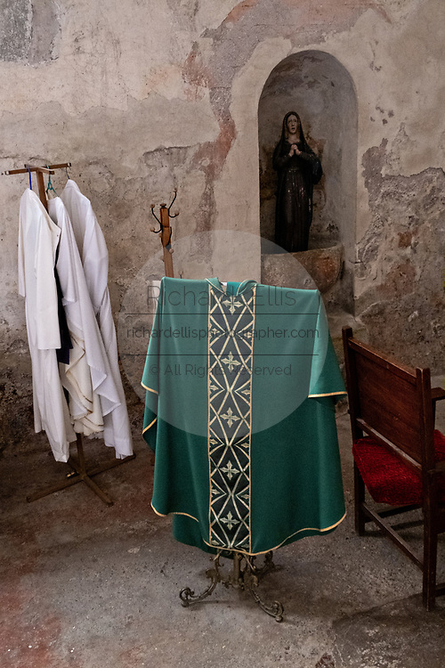 Priests vestments in the San Nicolas Tolentino Temple and Ex-Monastery in Actopan, Hidalgo, Mexico. The colonial church and convent  was built in 1546 and combine architectural elements from the romantic, gothic and renaissance periods.