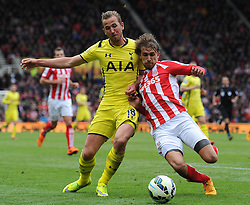 Tottenham Hotspur's Harry Kane is tackled by Stoke City's Marc Muniesa - Photo mandatory by-line: Dougie Allward/JMP - Mobile: 07966 386802 - 09/05/2015 - SPORT - Football - Stoke - Britannia Stadium<br />  - Stoke v Tottenham Hotspur - Barclays Premier League