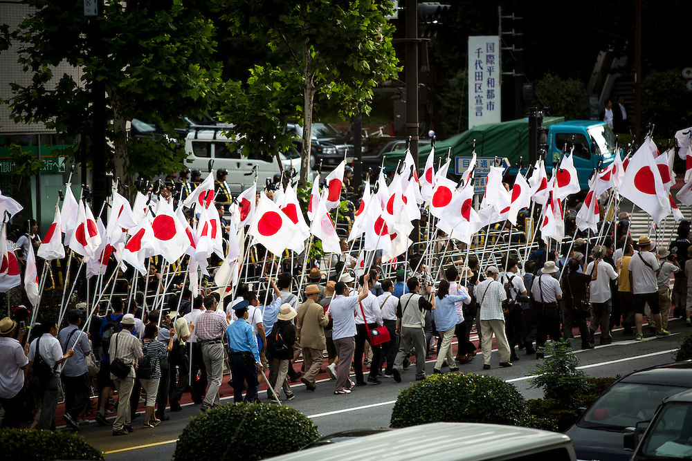 TOKYO, JAPAN - AUGUST 15 : Members of nationalist group march with national flags during an anti-Yasukuni demonstration near the Yasukuni Shrine on August 15, 2016 in Tokyo, Japan. Japan marked the 71st anniversary of the end of World War II. (Photo by Richard Atrero de Guzman/NURPhoto)