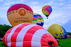 Strathaven Scotland UK 27th August 2016 - The Strathaven Balloon Festival is an annual event and the only one of its kind in Scotland held in 2016 from 26th - 28th August. The first flights of the festival took place at dawn on Saturday 27th August <br /> <br /> First balloons take to the sky on a beautiful calm morning.<br /> <br /> (c) Andrew Wilson   Edinburgh Elite media