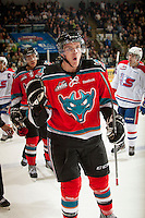 KELOWNA, CANADA - OCTOBER 10:  Mitchell Wheaton #6 of the Kelowna Rockets skates to the bench to celebrate a goal against the Spokane Chiefs  at the Kelowna Rockets on October 10, 2012 at Prospera Place in Kelowna, British Columbia, Canada (Photo by Marissa Baecker/Shoot the Breeze) *** Local Caption ***