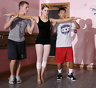 Tyler Long (left) and Zach York (right) both from Bellbrook prepare to lift __ at a rehearsal for the year-end recital at Terre's Dance Workshop in Kettering, Tuesday, May 8th.