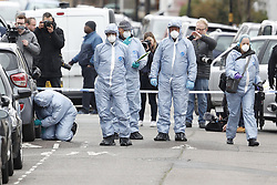 © Licensed to London News Pictures. 03/04/2018. London, UK. Police in protective overalls conduct a detailed search at the scene in Chalgrove Road, Tottenham, north London where a 17 year old girl was shot dead. The girl was found with a bullet wound and pronounced dead at the scene at 21:43 last night. Police were also called to another shooting and stabbing incident in Walthamstow. Photo credit: Peter Macdiarmid/LNP