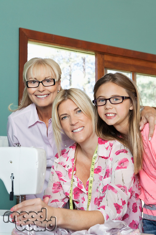 Portrait of granddaughter, grandmother and mother with sewing machine