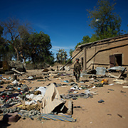 January 21, 2013 - Diabaly, Mali: A french army man checks the Mali military base in central Diabaly, for unexploded ordinance, a day after Mali government troops regain control of the city. Diabaly was under islamist militants control since the 14th of January...Several insurgent groups have been fighting a campaign against the Malian government for independence or greater autonomy for northern Mali, an area known as Azawad. The National Movement for the Liberation of Azawad (MNLA), an organisation fighting to make Azawad an independent homeland for the Tuareg people, had taken control of the region by April 2012...The Malian government pledge to the French army to help the national troops to stop the rebellion advance towards the capital Bamako. The french troops started aerial attacks on rebel positions in the centre of the country and deployed several hundred special forces men to counter attack the advance on the ground. (Paulo Nunes dos Santos/Polaris)