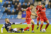 Millwall midfielder Jirí Skalák (26) tugs on the shorts of Nottingham Forest defender Tobias Figueiredo (3) during the EFL Sky Bet Championship match between Millwall and Nottingham Forest at The Den, London, England on 6 December 2019.