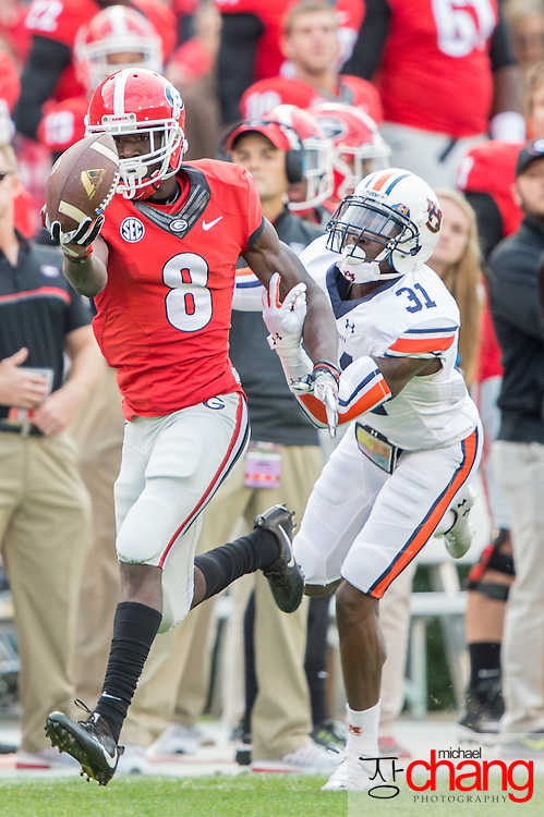 ATHENS, GA - NOVEMBER 12: Wide receiver Riley Ridley #8 of the Georgia Bulldogs catches a pass in front of defensive back Javaris Davis #31 of the Auburn Tigers at Sanford Stadium on November 12, 2016 in Athens, Georgia. The Georgia Bulldogs defeated the Auburn Tigers 13-7. (Photo by Michael Chang/Getty Images) *** Local Caption *** Riley Ridley; Javaris Davis
