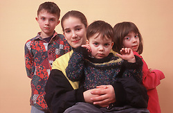 Group of young children standing together,