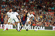 Lionel Messi is fouled by Cristiano Ronaldo. Barcelona v Real Madrid, Supercopa first leg, Camp Nou, Barcelona, 23rd August 2012...Credit : Eoin Mundow/Cleva Media