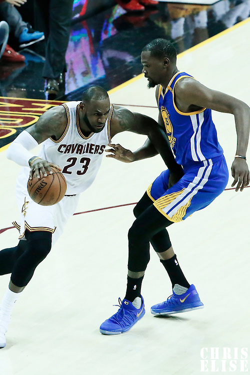 07 June 2017: Cleveland Cavaliers forward LeBron James (23) drives past Golden State Warriors forward Kevin Durant (35) during the Golden State Warriors 118-113 victory over the Cleveland Cavaliers, in game 3 of the 2017 NBA Finals, at  the Quicken Loans Arena, Cleveland, Ohio, USA.