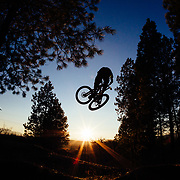 Kent Billingsley gets air off a jump in the woods of Missoula, Montana.