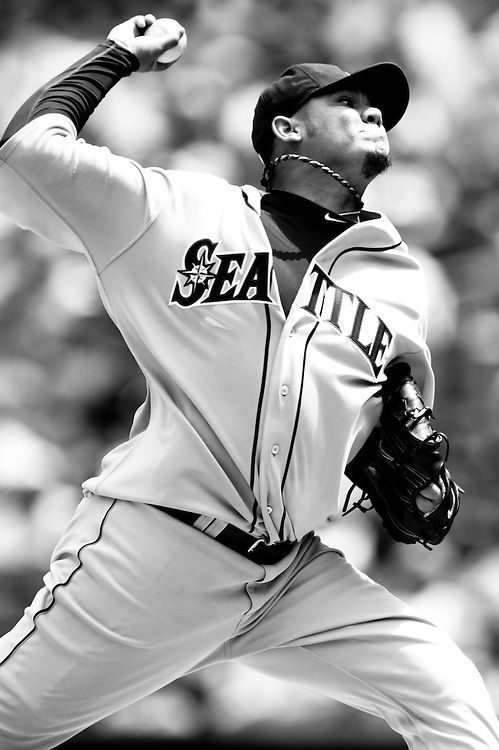 NEW YORK - JULY 27: ***EDITORS NOTE*** This image was digitally converted to Black & White) Felix Hernandez #34 of the Seattle Mariners pitches during the game against the New York Yankees at Yankee Stadium on July 27, 2011 in the Bronx borough of Manhattan. (Photo by Rob Tringali) *** Local Caption *** Felix Hernandez