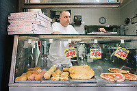 NAPLES, ITALY - 13 JULY 2017: Pizzas and fried food are sold here at Pizzeria Di Matteo in Via dei Tribunali in Naples, Italy, on July 13th 2017.