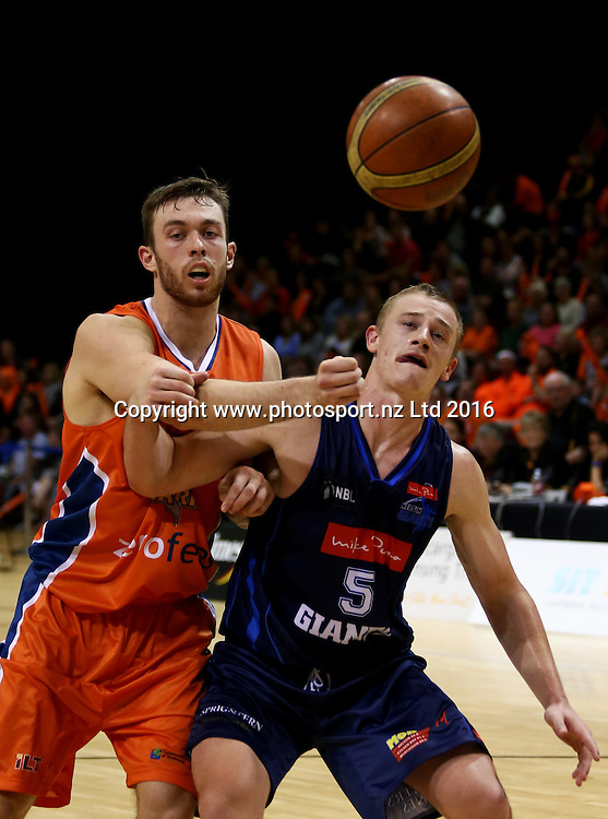 Alex Pledger of the Sharks (L) and Finn Delany of the Giants contest the ball in the NBL basketball match between the Southland Sharks and Nelson Giants, ILT Stadium Southland, Invercargill, Saturday, March 12, 2016. Photo: Dianne Manson / www.photosport.nz