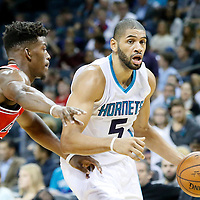 03 November 2015: Charlotte Hornets forward Nicolas Batum (5) drives past Chicago Bulls guard Jimmy Butler (21) during the Charlotte Hornets  130-105 victory over the Chicago Bulls, at the Time Warner Cable Arena, in Charlotte, North Carolina, USA.