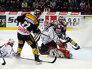 Kloten Flyers forward Victor Stancescu (CL) scores a goal past ZSC Lions goaltender Ari Sulander (CR) to the score of 2-0, while teammate Mark Bell (R) brings himself in position and ZSC Lions defender Pascal Mueller (L) tries to intercept during ice hockey game five of the Swiss National League A Playoff Quarterfinal between Kloten Flyers and ZSC Lions held at the Kolping Arena in Kloten, Switzerland, Tuesday, March 8, 2011. (Photo by Patrick B. Kraemer / MAGICPBK)