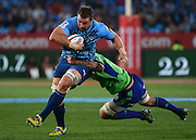 PRETORIA, South Africa, 18 MAY 2013 : Flip van der Merwe of the Bulls powering forward with Josh Bekhuis of the Highlanders making the tackle during the SupeRugby match between the BULLS and the HIGHLANDERS at Loftus Versfeld in Pretoria, South Africa on 18 MAY 2013. Bulls 35 - 18 Highlanders.<br /> <br /> © Anton de Villiers / SASPA