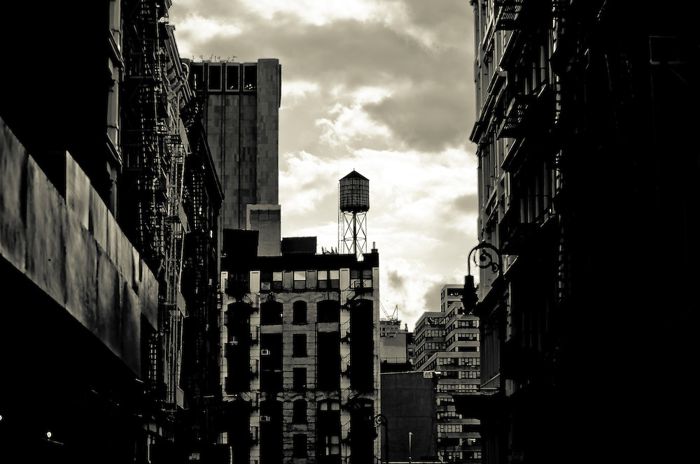 Water tank on a roof of a SoHo building as seen from Greene street in Manhattan, new york, 2009.