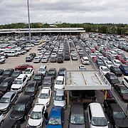 Rental cars remain unrented at the Orlando International Airport due to the Coronavirus (Covid-19) outbreak on Friday, April 17, 2020 in Orlando, Florida. (Alex Menendez via AP)