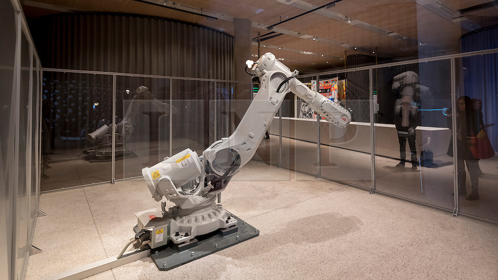 © Licensed to London News Pictures. 17/11/2016. London, UK. A working industrial robot on show as The Design Museum opens in its new home on Kensington High Street, west London.  Housed in the former Commonwealth Institute, the building has been redesigned by John Pawson following an investment of £83m, and a five-year construction process for its future role as the world's leading institution dedicated to contemporary design and architecture. Photo credit : Stephen Chung/LNP