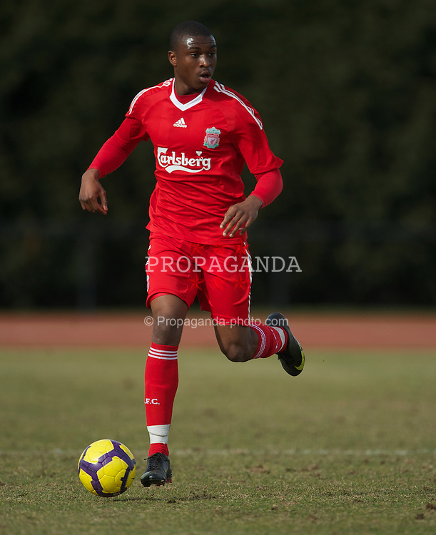 WIGAN, ENGLAND - Wednesday, March 17, 2010: Liverpool Reserves' David Amoo in action against Wigan Athletic Reserves during the Lancashire Senior Cup Semi-Final at the Robin Park Sports Arena. (Photo by David Rawcliffe/Propaganda)