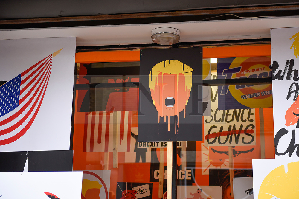 """© Licensed to London News Pictures. 02/06/2019. LONDON, UK.  An exhibition of artwork entitled """"Hell is Empty"""" by Edel Rodriguez depicting Donald Trump is on display near Brick Lane in East London.  Donald Trump is due to arrive on a State Visit to the UK on 3 June.  Photo credit: Stephen Chung/LNP"""