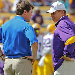 October 8, 2011; Baton Rouge, LA, USA;  LSU Tigers head coach Les Miles talks with Florida Gators head coach Will Muschamp prior to kickoff of a game at Tiger Stadium.  Mandatory Credit: Derick E. Hingle-US PRESSWIRE / © Derick E. Hingle 2011