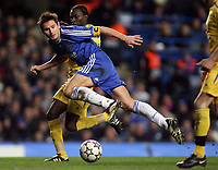 Photo: Paul Thomas.<br /> Chelsea v Levski Sofia. UEFA Champions League, Group A. 05/12/2006. <br /> <br /> Frank Lampard (Blue) of Chelsea gets tackled by Richard Eromoigbe.