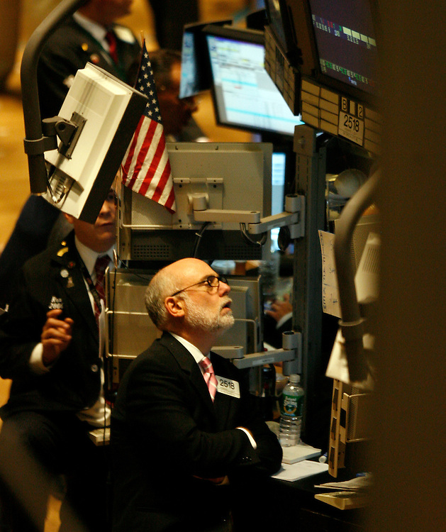 Traders on the floor of the New York Stock Exchange Friday 14 July 2006.  The Dow Jones Industrial average fell 106.94 points