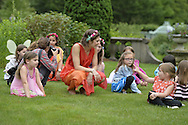 Old Westbury, New York, USA. 28th June 2015. Lori Belilove & The Isadora Duncan Dance Company, dressed in Greek, Roman, and Renaissance themed tunics, give dancing lessons to children throughout the gardens, and then perform on the South Lawn in front of the Mansion of historic Old Westbury Gardens, a Long Island Gold Coast estate, for its Midsummer Night event.