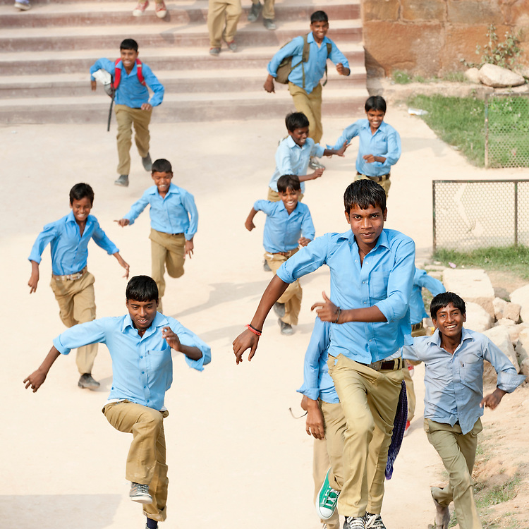 Indian schoolboys run around the grounds on a school visit to Qutub Minar
