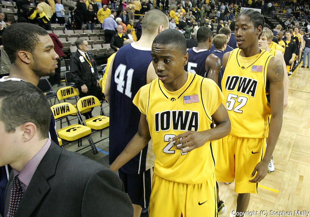 24 JANUARY 2007: Iowa guard Justin Johnson (24) and forward Kurt Looby (52) after Iowa's 79-63 win over Penn State at Carver-Hawkeye Arena in Iowa City, Iowa on January 24, 2007.