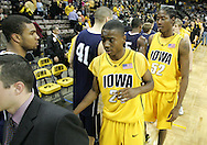 24 JANUARY 2007: Iowa guard Justin Johnson (24) and forward Kurt Looby (52) after Iowa's 79-63 win over Penn State at Carver-Hawkeye Arena in Iowa City, Iowa on January 24, 2007.