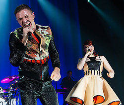 © Licensed to London News Pictures. 23/10/2012. London, UK.   Ana Matronic (centre) and Jake Shears (left) of Scissor Sisters performing live at Camden Roundhouse. Scissor Sisters are an American band formed in 2001.  The band took their name from a sexual position between two women also known as tribadism.  Its members comprise Jake Shears and Ana Matronic as vocalists, Babydaddy as multi-instrumentalist, Del Marquis as lead guitar/bassist, and Randy Real as drummer. Scissor Sisters have incorporated diverse and innovative styles in their music, but tend to sway towards pop rock, glam rock, nu-disco, and electroclash.  Photo credit : Richard Isaac/LNP