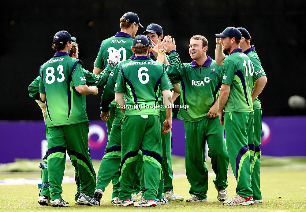 RSA Challenge ODI, Clontarf Cricket Club, Dublin, 25/8/2011<br />Ireland vs England<br />Ireland's Paul Stirling celebrates with his team after he caught and bowled Eoin Morgan of England<br />Mandatory Credit &copy;INPHO/James Crombie  *** Local Caption ***