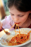 21 Apr 2006, Rome, Italy --- Girl Eating Spaghetti --- Image by © Owen Franken/Corbis