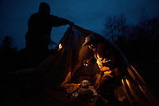 Marvin Farrin (R) sets a net to catch elvers in Pemaquid, Maine as his friend Zach Hill helps with lighting on Wednesday, March 28, 2012.  Craig Dilger for The New York Times